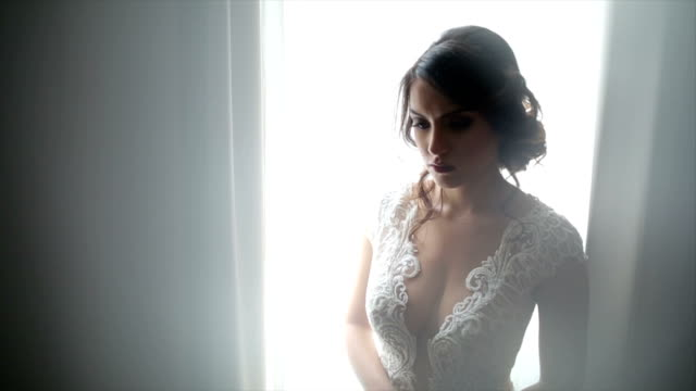 Attractive bride posing in her wedding dress