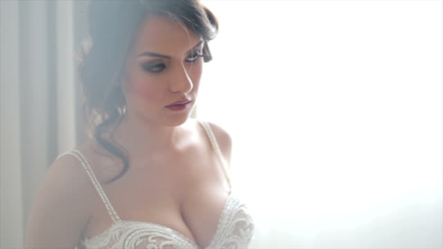 attractive bride posing in her wedding dress - bra stock videos & royalty-free footage