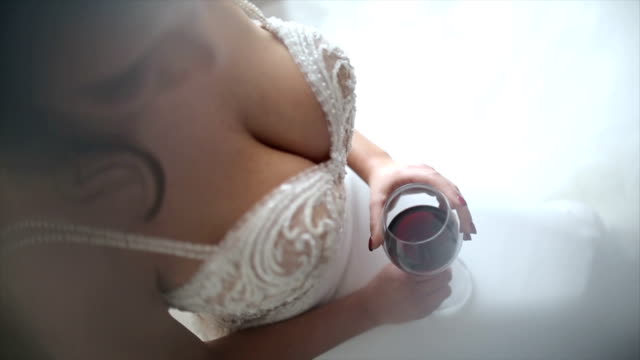 attractive bride with a glass of wine - barechested bare chested stock videos and b-roll footage