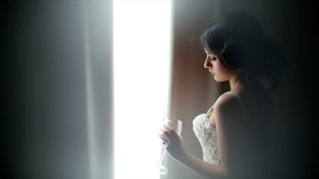 Attractive bride with a glass of wine