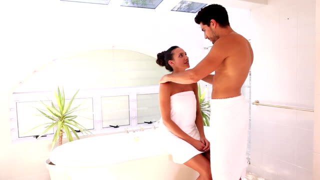 Attractive couple about to have a bath together