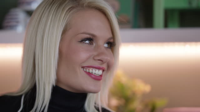 attractive couple in the cafe slow motion 4k - turtleneck stock videos & royalty-free footage