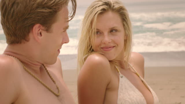 attractive couple sharing time together on a beach by the pacific 4k - vesper stock stock videos & royalty-free footage