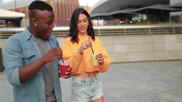 attractive couple tasting organic juices outdoors - juice drink stock videos & royalty-free footage