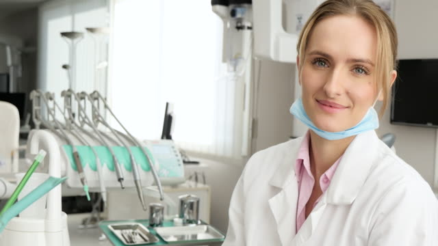 attractive dentist with thumb up - surgical mask stock videos and b-roll footage
