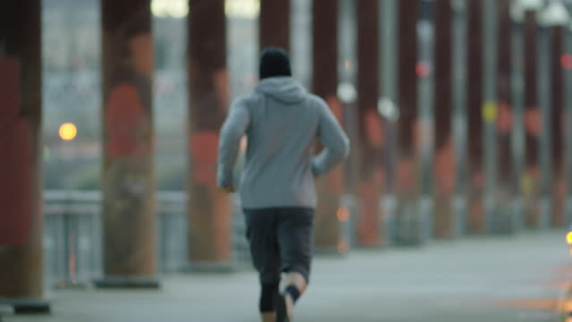 Attractive ethnic male exercising/running outdoors