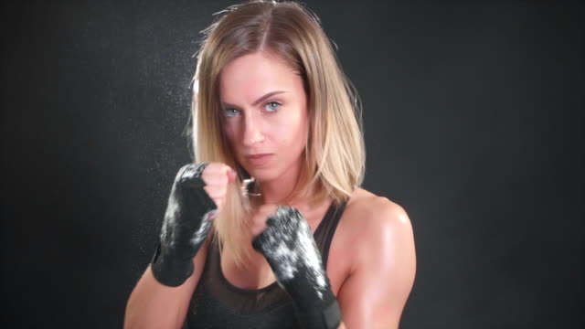 Attractive female boxer punching in super slow motion 120FPS