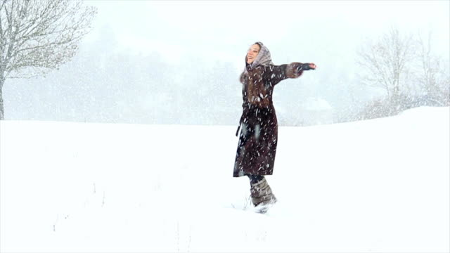 attractive girl playing in the snow