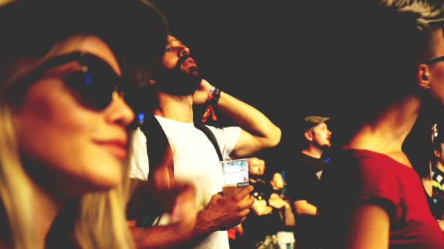 attractive hipster woman dancing on festival with friends - lightship stock videos & royalty-free footage