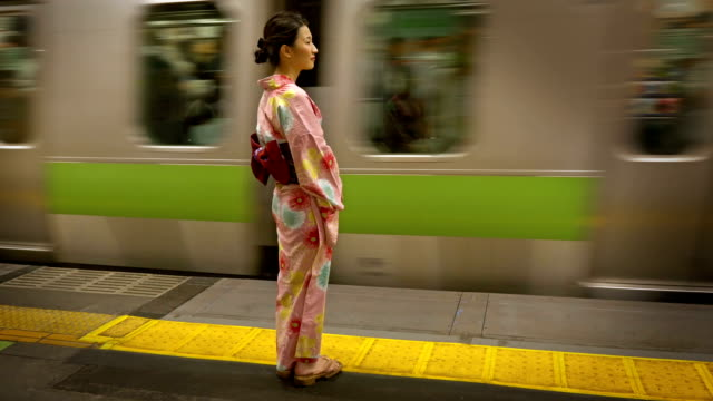 Attractive Japanese Woman Waiting On A Train Platform