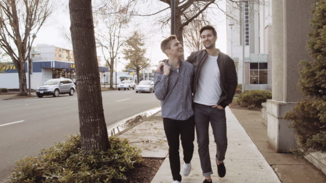 attractive male couple walking together - bisexuality stock videos and b-roll footage