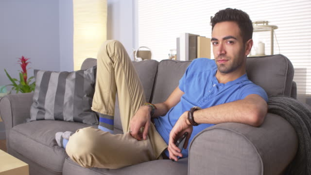 attractive man lying on couch - puerto rican ethnicity stock videos & royalty-free footage