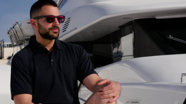 attractive man on yacht. - yachting stock videos and b-roll footage