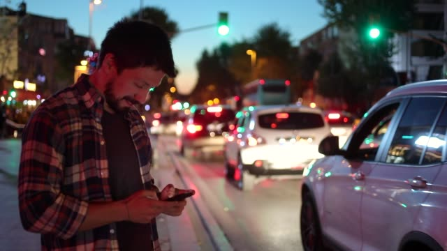 Attractive Man using Mobile Phone During Walk on Streets
