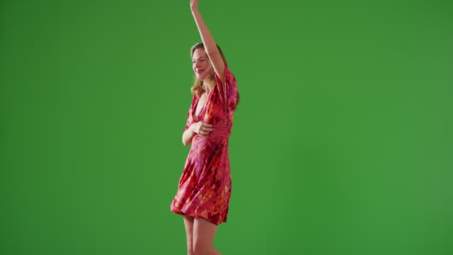 attractive middle aged caucasian woman in sundress dancing on green screen - entertainment occupation stock videos and b-roll footage