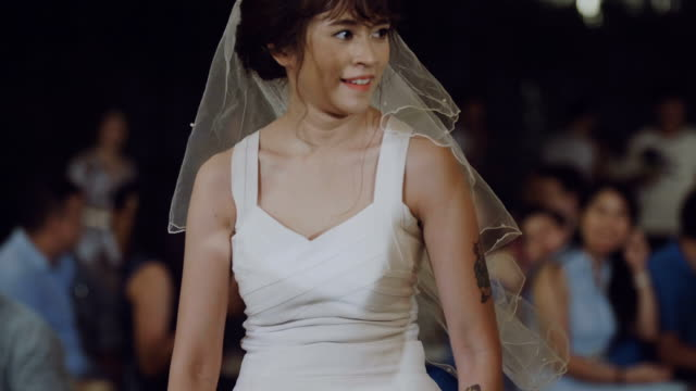 Attractive woman dancing in wedding day.