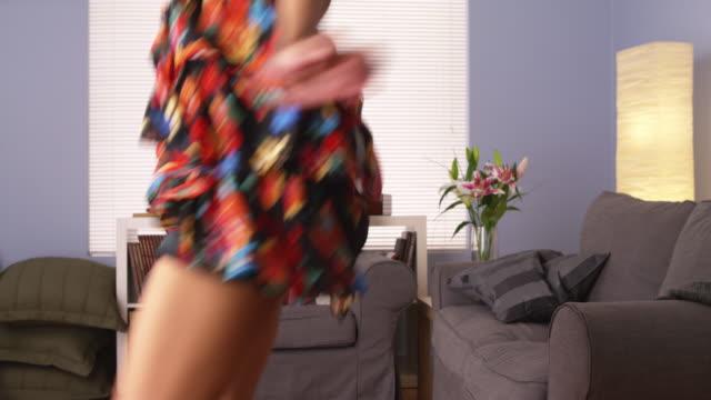 attractive woman dancing towards camera - プエルトリコ人点の映像素材/bロール