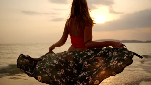 attractive woman enjoying summer on the beach - sarong stock videos & royalty-free footage