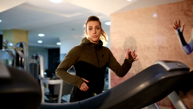 attractive woman on treadmill - cardiovascular exercise stock videos & royalty-free footage