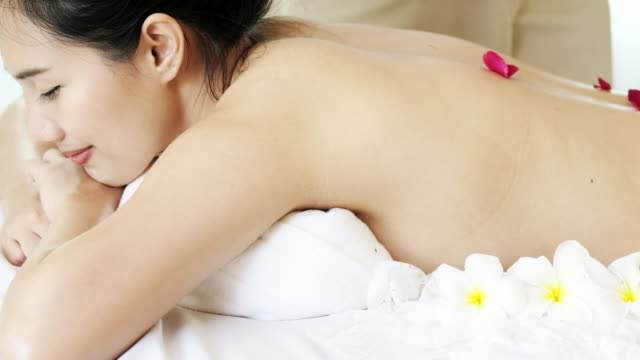 attractive woman receiving back massage for relax - afc women's asian cup stock videos and b-roll footage