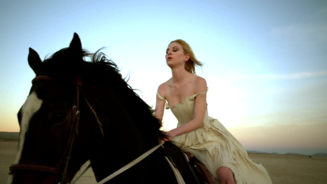 (slow motion) attractive woman riding horse 01 - horseback riding stock videos & royalty-free footage