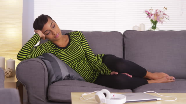 attractive woman sleeping on couch - short hair stock videos & royalty-free footage