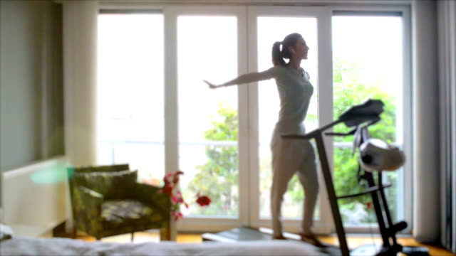 attractive woman walks on a treadmill, is engaged in home - treadmill stock videos & royalty-free footage