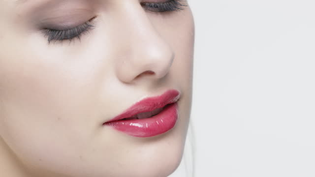 attractive woman with red lipstick and eyeshadow - lips stock videos & royalty-free footage