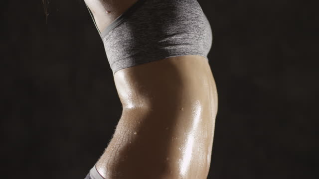 vídeos y material grabado en eventos de stock de attractive young athletic woman showing curvy body - torso