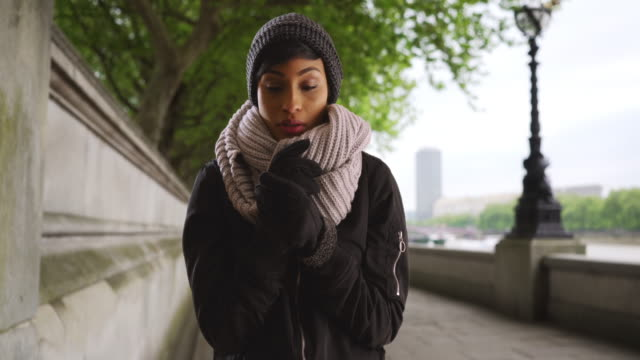 Attractive young black woman outside on overcast day in London, England