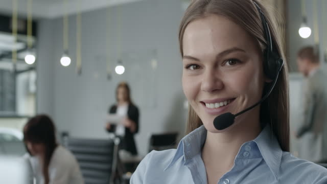 attractive young call center agent - headset stock videos & royalty-free footage