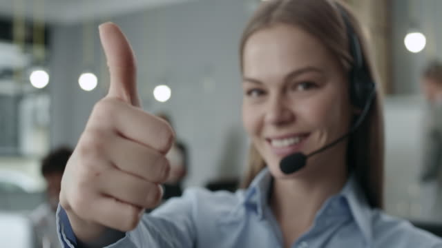 attractive young call center agent - call centre stock videos & royalty-free footage