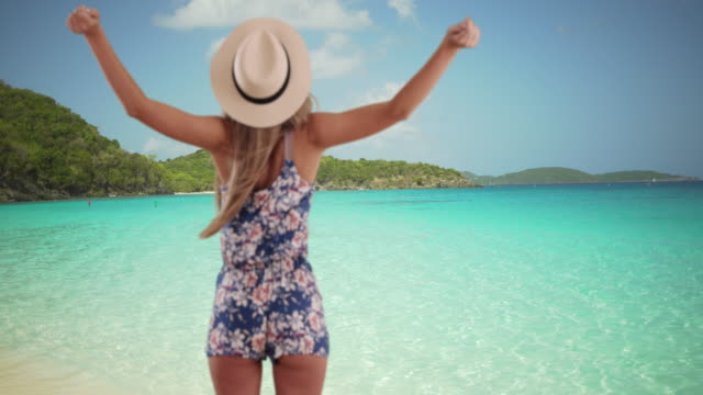 Attractive young Caucasian lady in summer clothes enjoying beach atmosphere