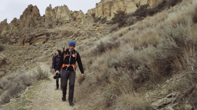 attractive young couple hiking - smith rock state park stock videos & royalty-free footage