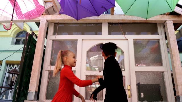 vídeos de stock e filmes b-roll de attractive young couple of children dancing salsa - arte, cultura e espetáculo