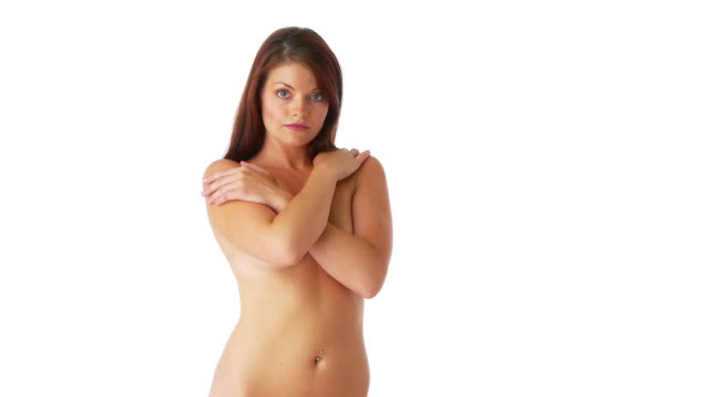 attractive young female covering breasts with arms - bauchnabelring stock-videos und b-roll-filmmaterial