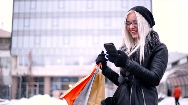 Attractive young girl in shopping during winter