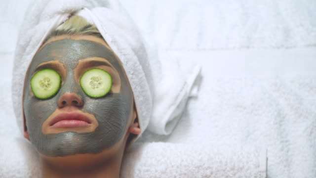 attractive young model spa skin care cucumber towel relaxed beautiful woman - spa stock videos & royalty-free footage