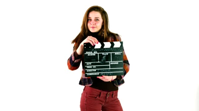 Attractive young woman clapping with film slate or claperboard