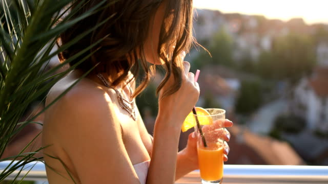 attractive young woman in bikini at poolside - orange juice stock videos & royalty-free footage