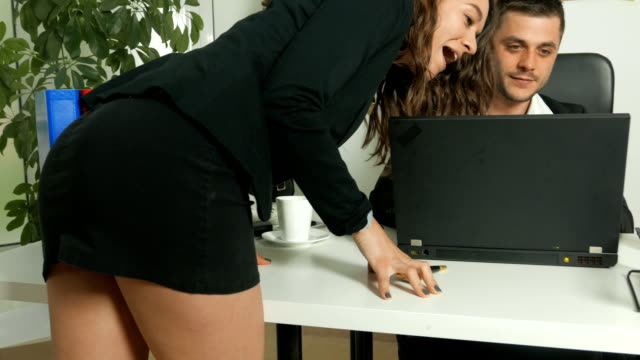 Attractive young woman secretary flirting with her manager