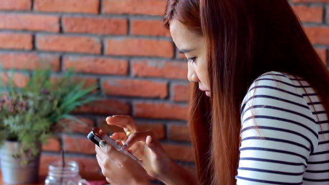 attractive young woman using smart phone in cafe - individuality stock videos & royalty-free footage