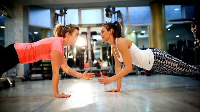 attractive young women exercising pilates at gym - exercise class stock videos & royalty-free footage