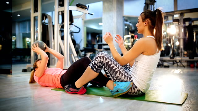 attractive young women exercising pilates with weight ball - strongwoman stock videos & royalty-free footage