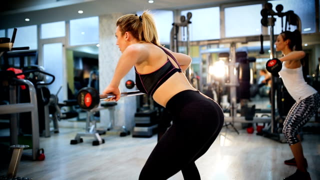 attractive young women exercising weight lifting - strongwoman stock videos & royalty-free footage