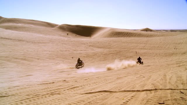 ws zi atvs and dirt bikes racing up and down steep sand dunes / glamis, california, usa - sand dune stock videos & royalty-free footage