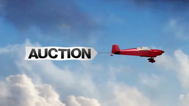 auktion flugzeug-banner (center - spruchband stock-videos und b-roll-filmmaterial