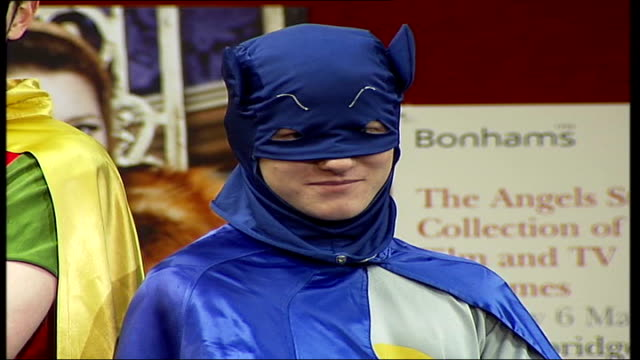 auction of film costumes owned by angels costumier; young men modelling 'batman and robin' costumes worn by actors david jason and nicholas lyndhurst... - only young men stock videos & royalty-free footage