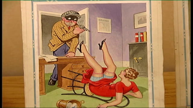 auction of saucy postcards leyburn tennants auctioneers int close shot postcard of robber and woman on floor with legs in air as voiceover caption... - fetishism stock videos & royalty-free footage
