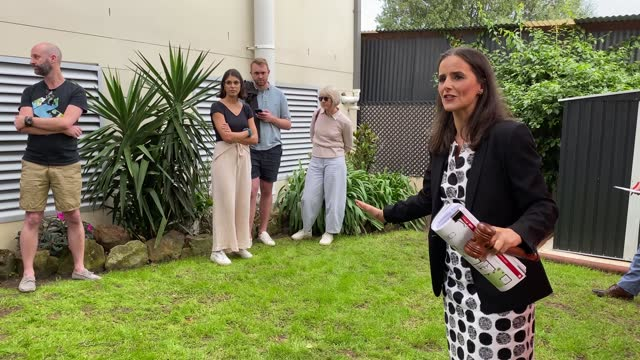 auctioneer karen harvey counts down a bid during an auction of residential property in hurlstone park on may 08 in sydney, australia. property prices... - bid stock videos & royalty-free footage